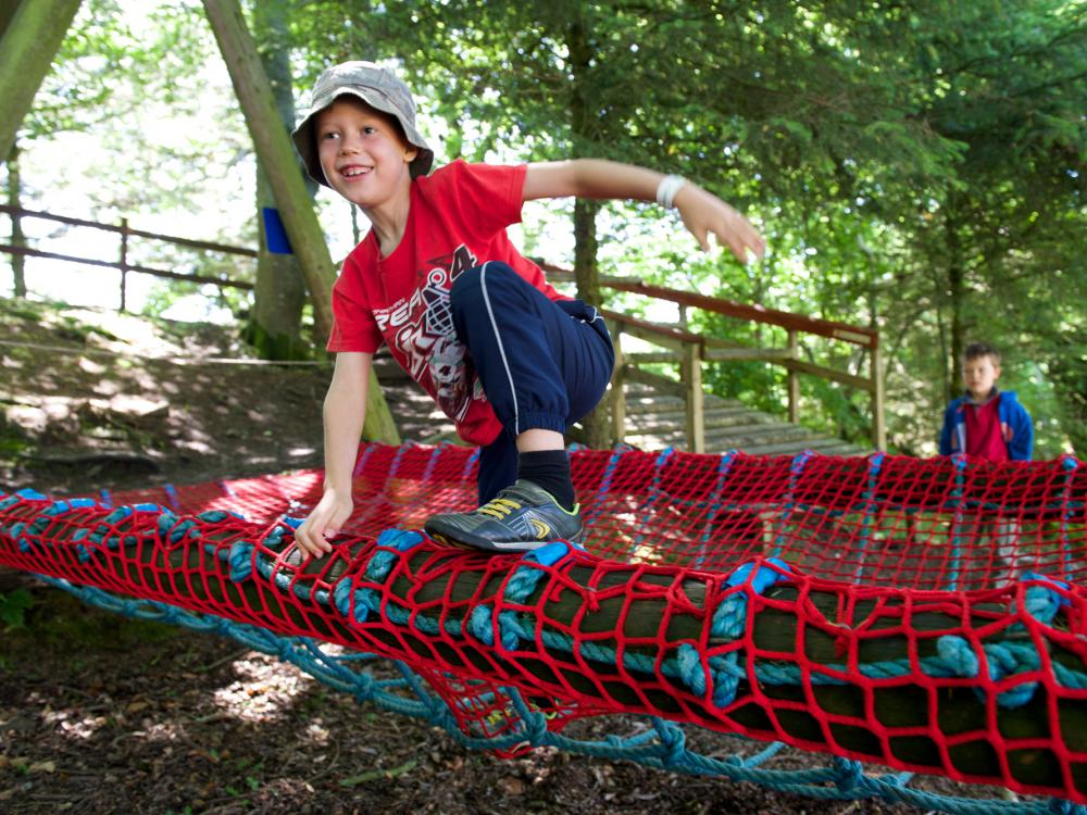 playing in the adventure playground nets